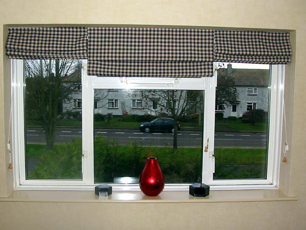 Large Window With Three Separate Roman Blinds