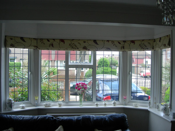 Large bay window for Roman shades for wide windows